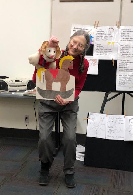 Children's Librarian, Alma Brown, and her puppet during the ending story time.