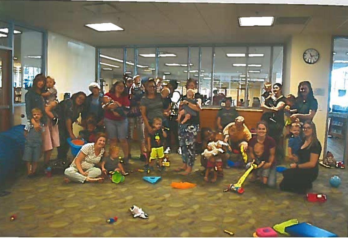 messy happy moms and kids, with misc. toys, a  group picture we took of our latest Baby Club (aka parent-child workshop)