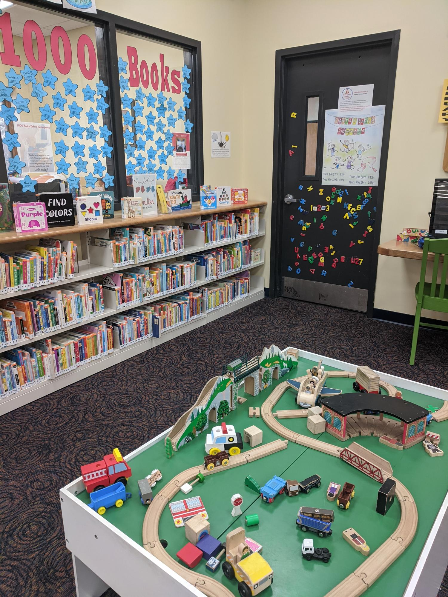 The train table draws kids like a magnet! The metal door is also a popular place for playing with magnetic letters and numbers.