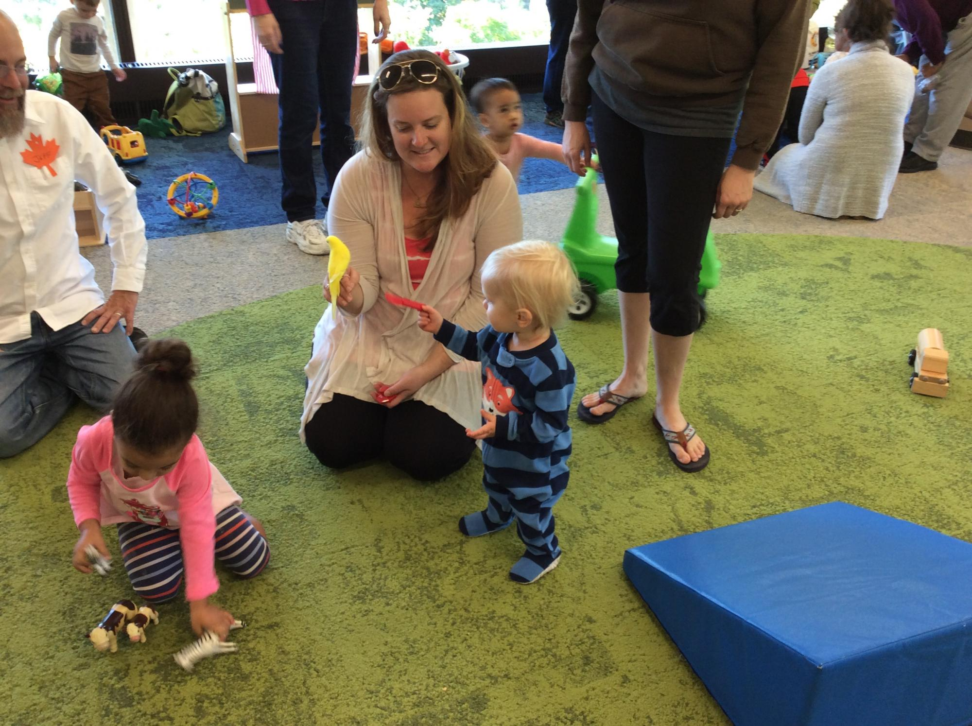 families playing in early childhood space