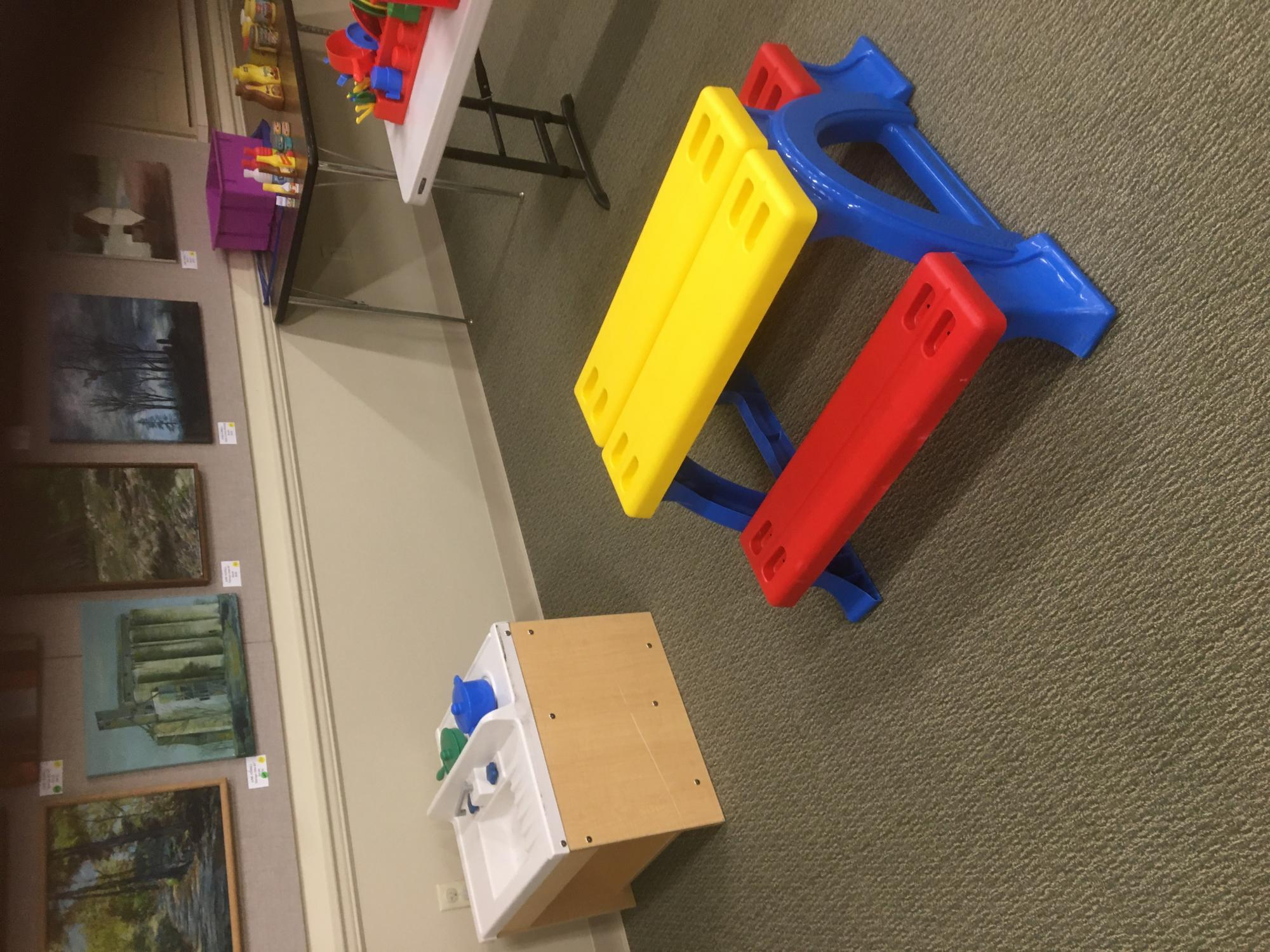 play shopping area with play food, picnic bench, dishes and play kitchen