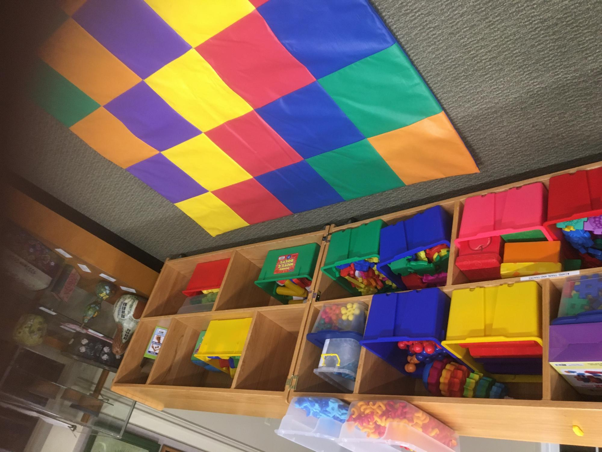 toy cart with colorful mat