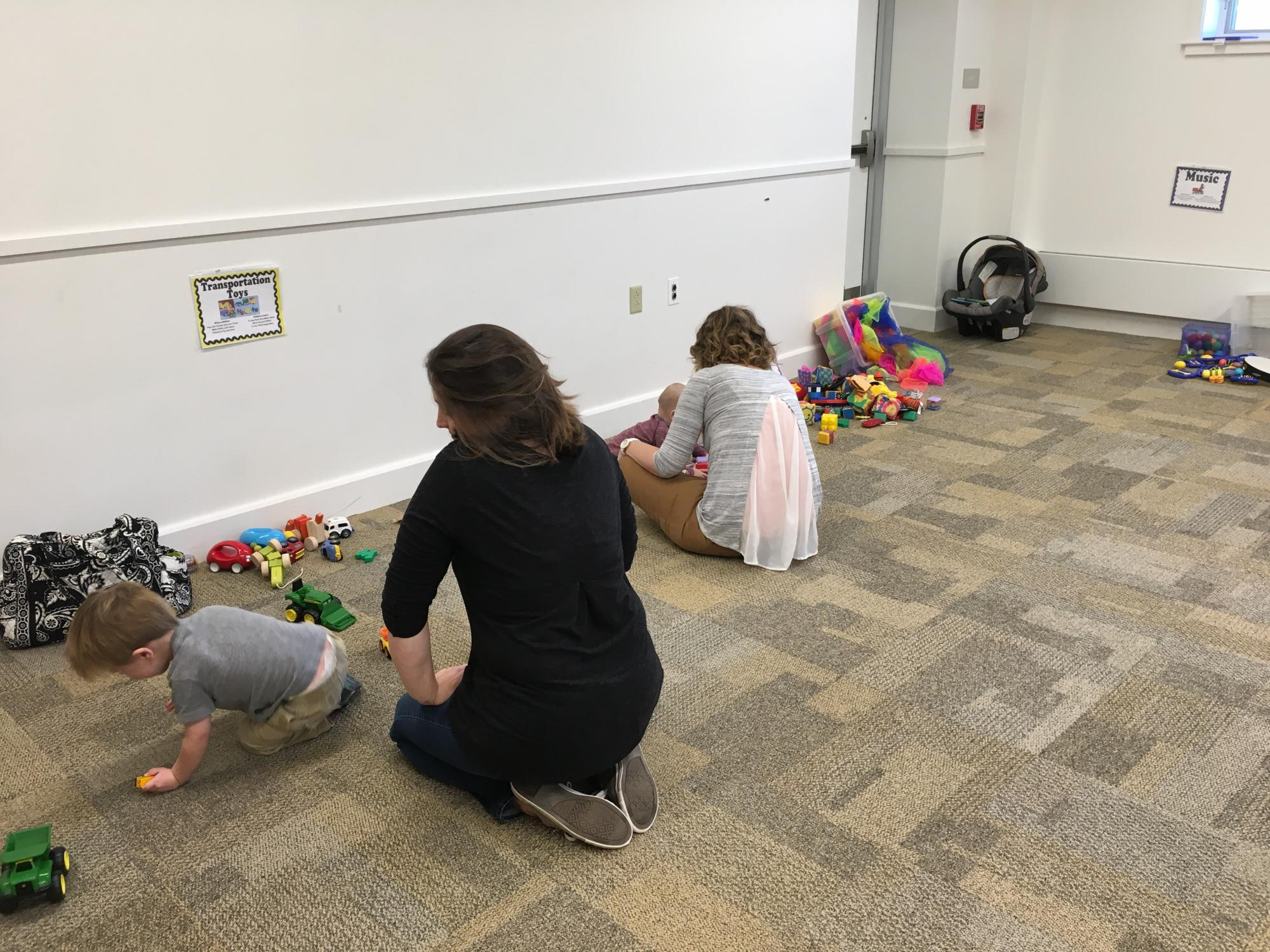 Some families beginning to play at the workshop last fall.