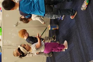 Playing with bubbles at a Baby Club program