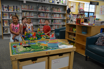 Children at the Deer Park Public Library utilizing their early childhood space.