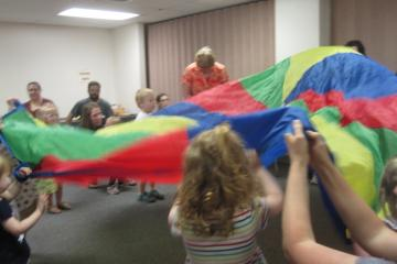 Parachute time with our Music and Movement resource professional at the PCW