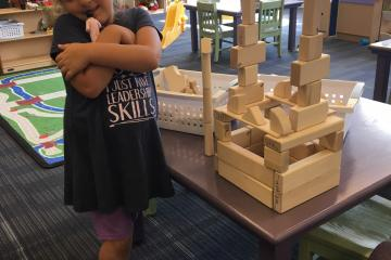 So proud of her tower with our new wooden blocks