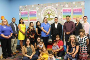 Library staff, families and community leaders at the Family Place Grand Opening
