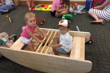Liberty and Alden in the row boat during the Stepping Stones Parent Caregiver Workshop at the Harker Heights Public Library