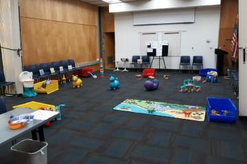 The toys are set out in the meeting room for 1-2-3 Play with Me.